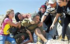 Palestinians scuffle with Israeli soldier