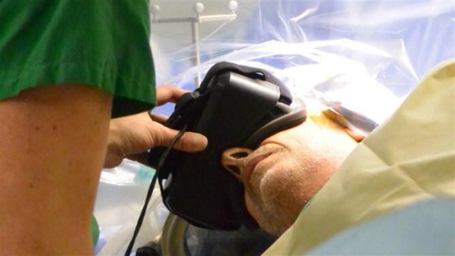 Patient wears 3-D glasses during brain surgery