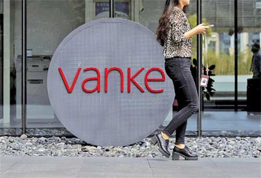 Evergrande lifts stake in Vanke to nearly 7% in battle for control
