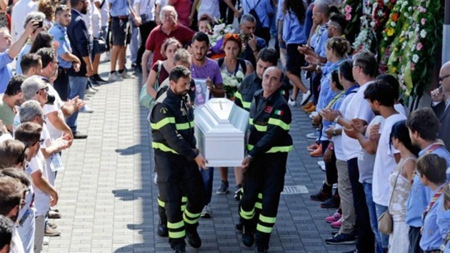 Italy begins to bury earthquake dead