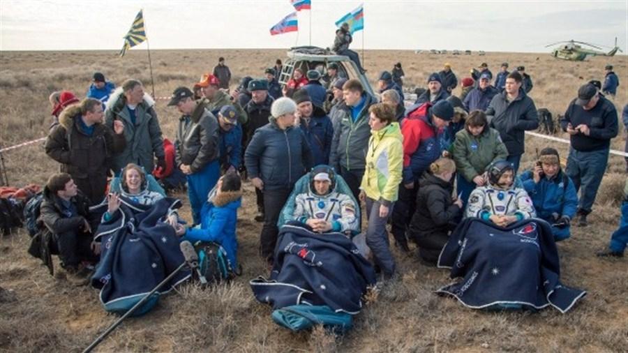 ISS astronauts return