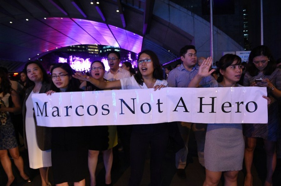 Protests after Marcos buried in heroes' cemetery