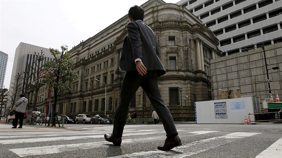 BOJ raises view of economy in over a year