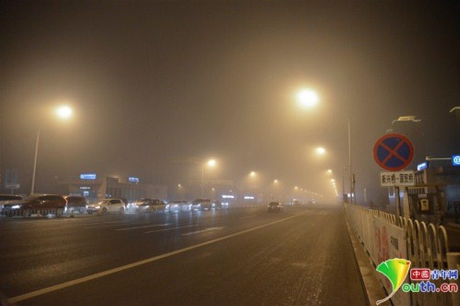 Parts of N. China under cover of smog on New Year's Day