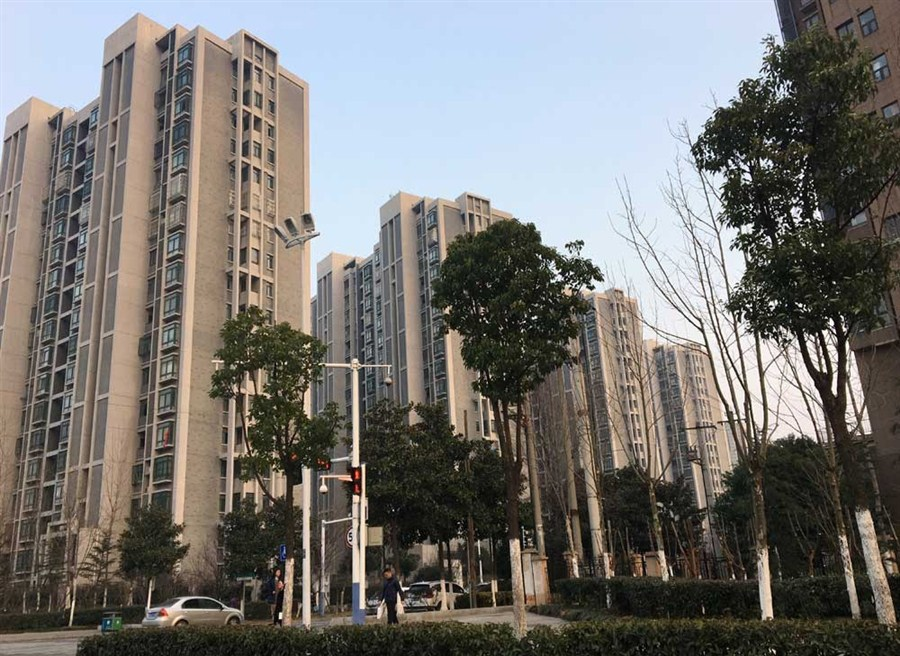 China vows to control home prices