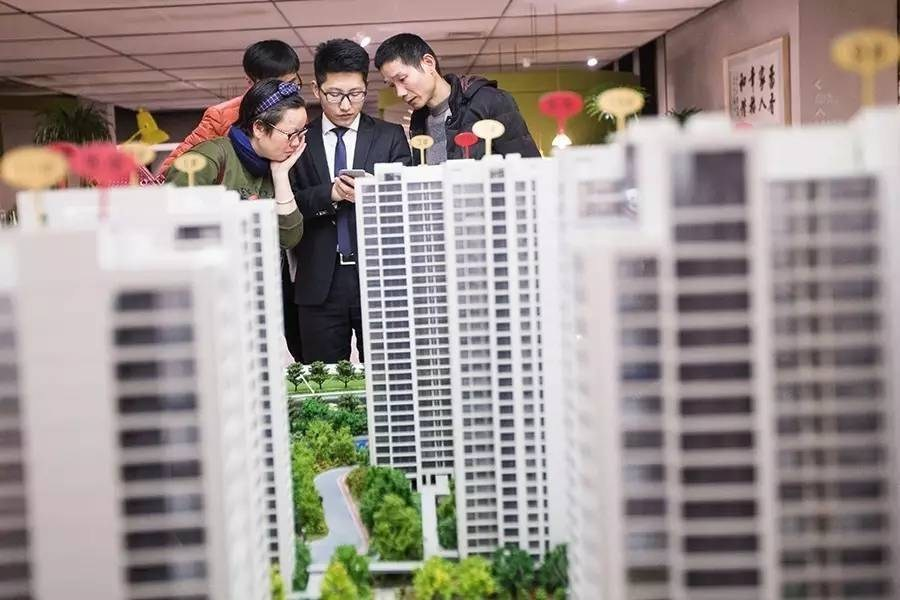 China tightens housing loan rules to cool Beijing's property market