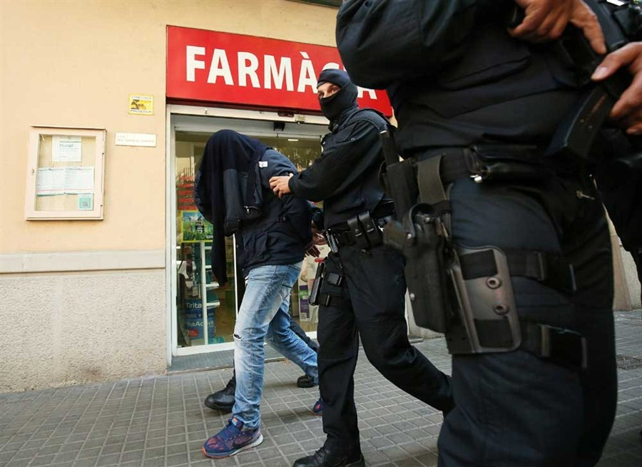 9 arrested as Spanish police hold dawn raids
