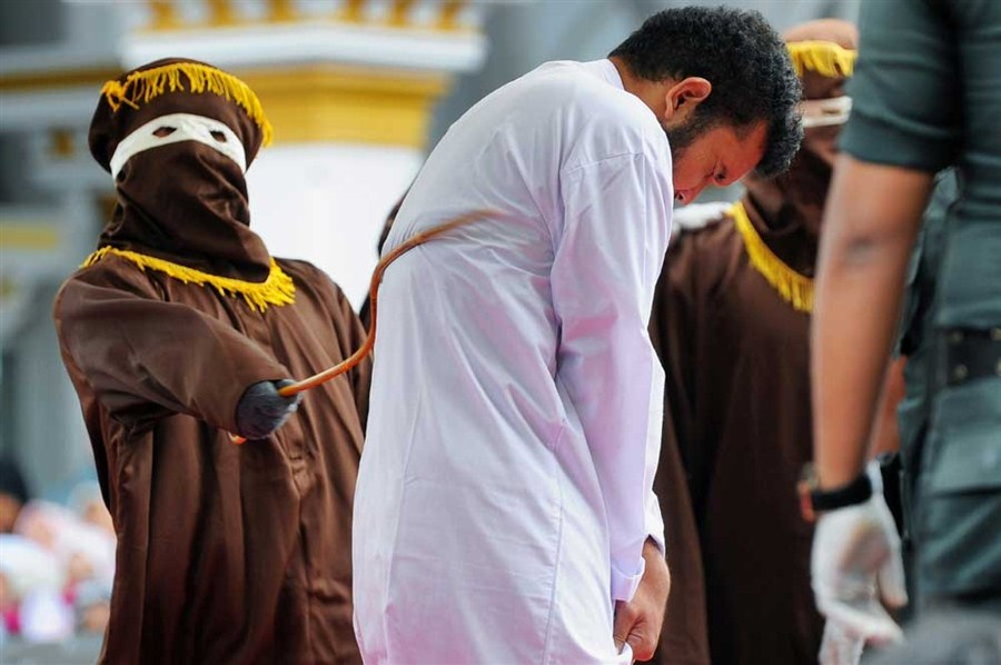 Crowd jeers as Indonesian men caned for gay sex