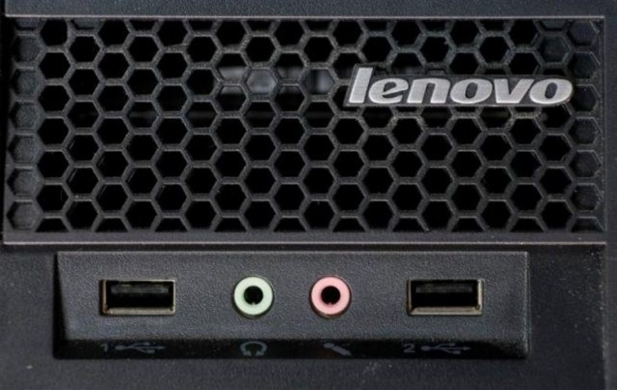 Lenovo sees profit, warns of price stress
