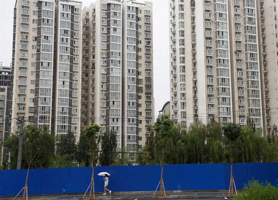 Housing boom cooling on tough controls