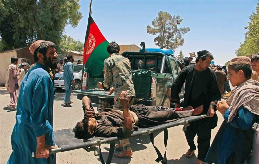 Taliban car bombing at Afghan bank kills 34