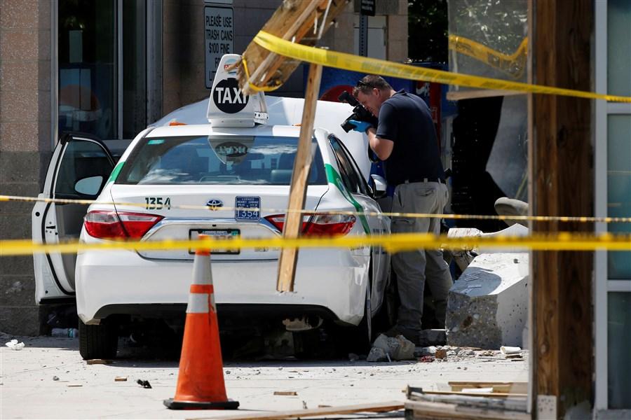 Boston airport taxi crash injures 10: police