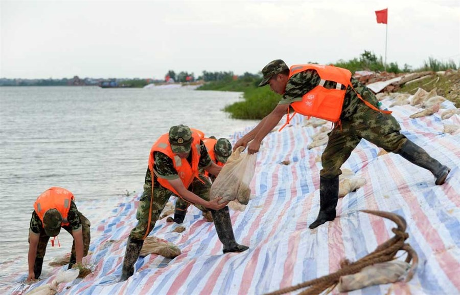 Death toll rises as flooding causes chaos