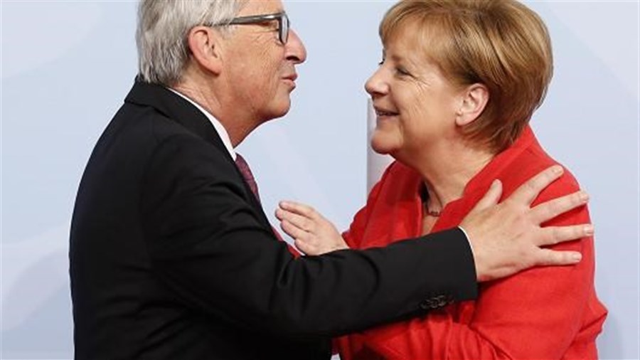 Juncker press conference interrupted by wife... no, Merkel