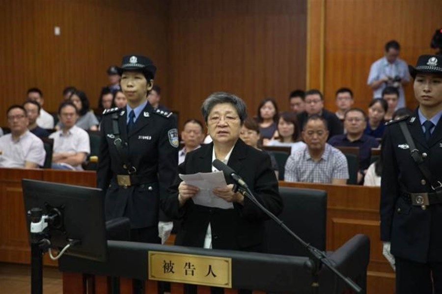 """Red notice"" fugitive stands trial for embezzlement, accepting bribes"