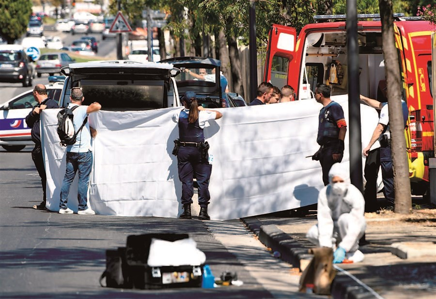 Woman dies as van plows into French bus stops