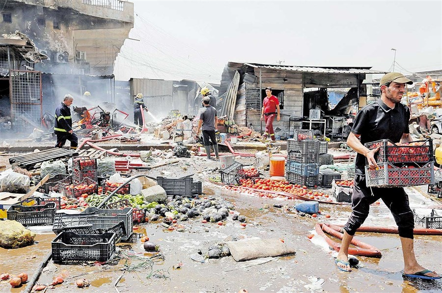11 die in Iraqi market bomb attack