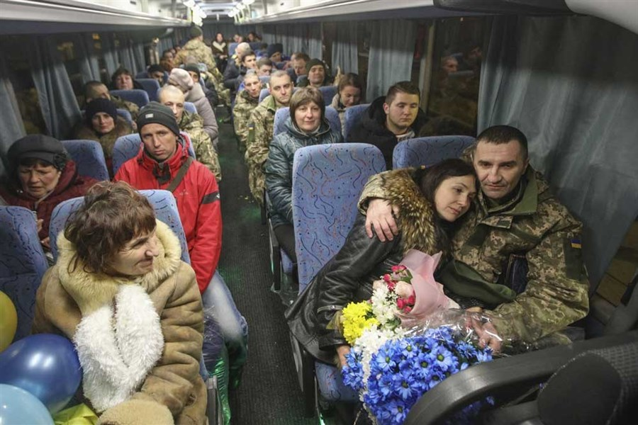 Freed POWs reunite with families