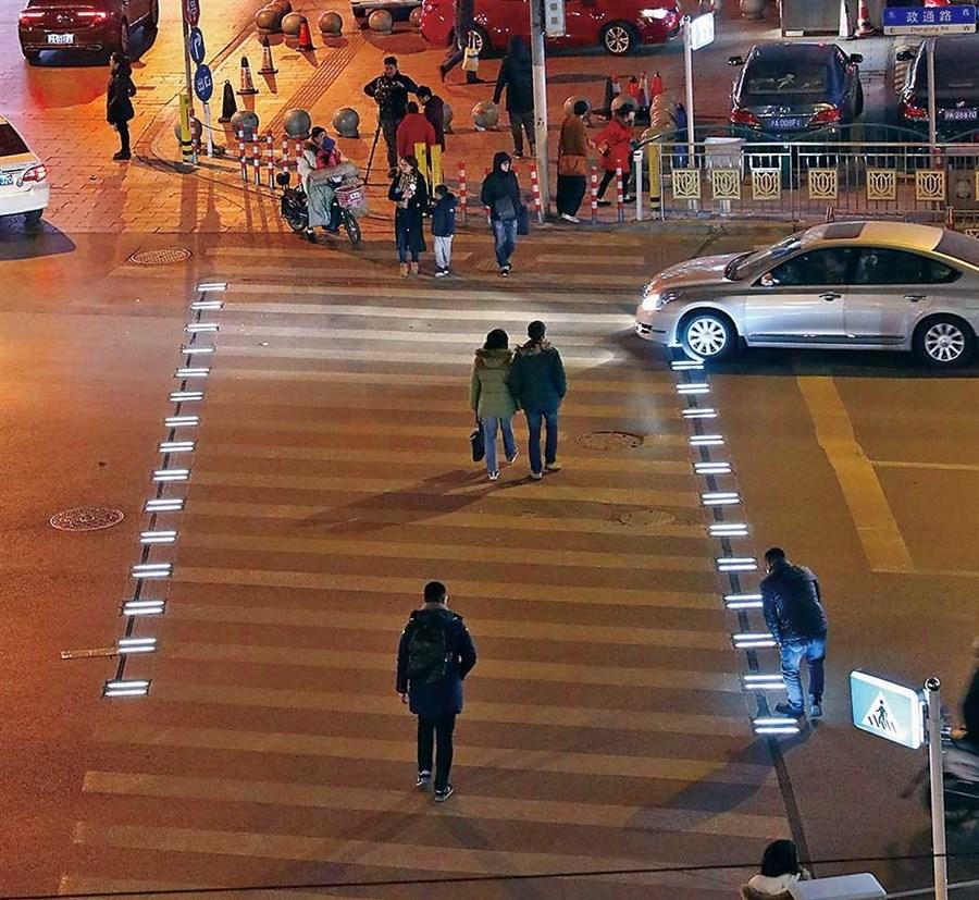 Yangpu tries out a lighted zebra crossing