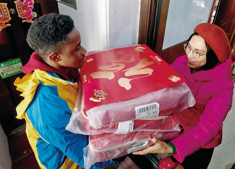 Foreign students cash in delivering holiday parcels