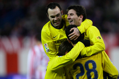 Barcelona\'s Leo Messi (Right) celebrates his second goal with his teammates during their Spanish King\'s Cup soccer match against Atletico Madrid at Vicente Calderon stadium in Madrid yesterday.