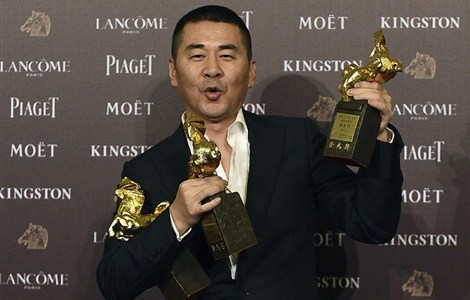 Chen Jianbin celebrates with his awards at the Golden Horse Film Awards in Taipei. -- Reuters