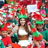 People dress as Santa's Elves gather to break Guinness World Records
