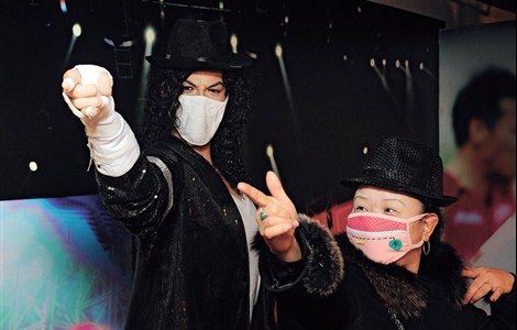 A young visitor in a pollution mask at the wax museum in Taiyuan City, capital of Shanxi Province, strikes a pose beside a waxwork of late US pop singer Michael Jackson — who often wore a pollution mask. However, other wax figures in the museum are also sporting pollution masks after the museum launched a campaign in protest against air pollution.