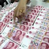 China's central bank cuts RRR by 1%