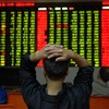 Chinese shares down 3.25% at end of volatile morning