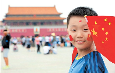 A boy celebrates Beijing's