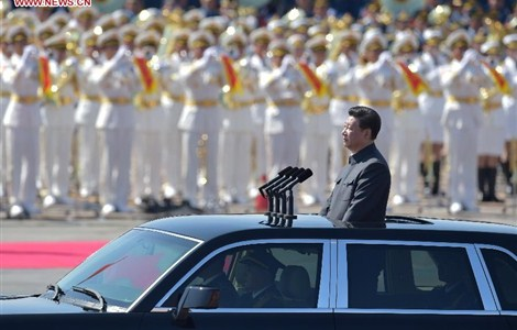 Chinese President Xi Jinping inspects troops of the Chinese People's Liberation Army during the commemoration activities to mark the 70th anniversary of the victory of the Chinese People's War of Resistance Against Japanese Aggression and the World Anti-Fascist War, in Beijing, capital of China, Sept. 3, 2015.
