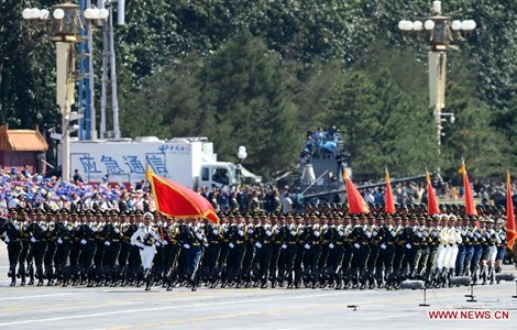 Honor guards of the three services of the Chinese People's Liberation Army (PLA) attend a parade in Beijing, capital of China, Sept. 3, 2015.