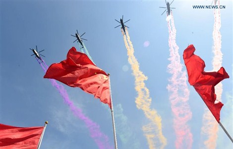 Helicopters attend a parade in Beijing, capital of China, Sept. 3, 2015.
