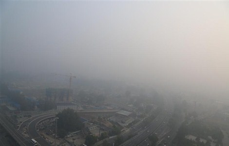 Part of Beijing, capital of China, is shrouded by mist and smog on Oct. 6, 2015.