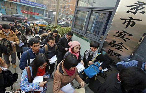 Candidates arrive to take the civil servant exam in Beijing, capital of China, Nov. 29.