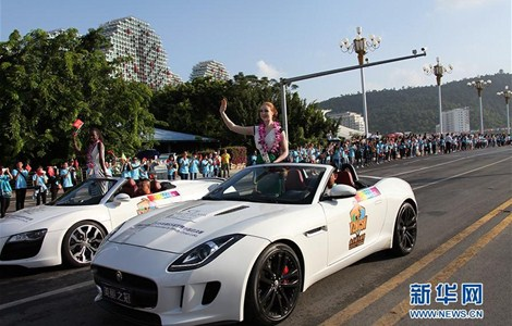 Contestants of the 65th Miss World Competition take part in a parade in Sanya, south China's Hainan Province, Nov. 29.