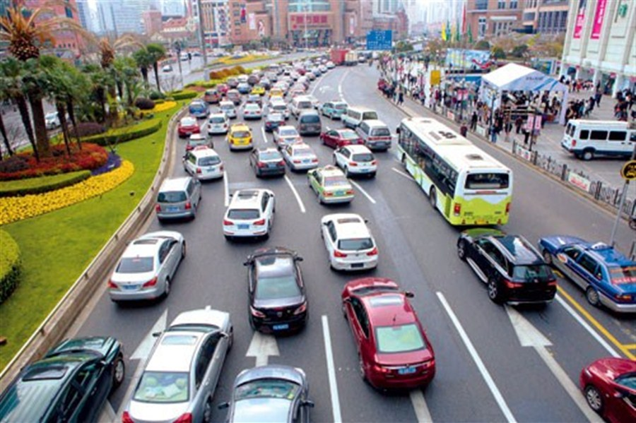 traffic builds up on a busy road in downtown xuhui district yesterday the number of cars in shanghai rose by 13 percent last year its fastest increase for
