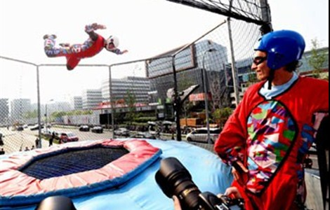 """A man takes a simulated skydive at an outdoor wind tunnel in Hongqiao area yesterday. The """"ride,"""" for which tickets cost between 78 (US$12) and 128 yuan, opens to the public tomorrow."""