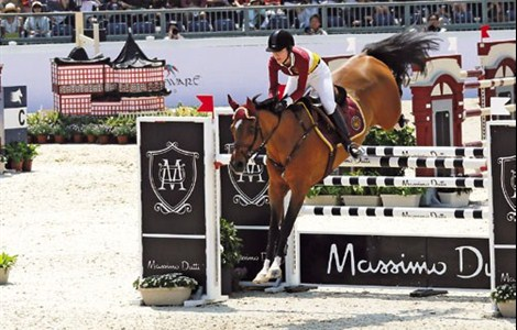 Britain's Alexandra Thornton of Team Shanghai Swans clears a hurdle during the Global Champions League contest on the last day of the Shanghai leg of the Global Champions Tour, a five-star show jumping event, near the China Art Museum in Pudong New Area yesterday. The Swans finished 7th among 12 teams in the GCL.