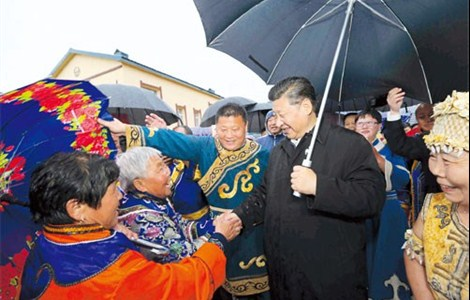 President Xi Jinping talks with ethnic Hezhe people in Tongjiang, a city in northeast China's Heilongjiang Province, during an inspection tour. Xi said China's 56 ethnic groups are one family and none will be left behind on the road to prosperity.
