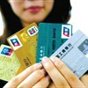 China's bank card transactions soar 87% in 2015