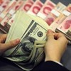 Chinese yuan weakens to six-year low against USD