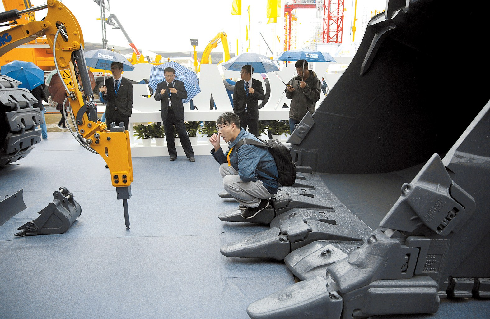 People look at heavy machinery of XCMG at Bauma China 2016, a trade fair for construction machinery held in Shanghai this week. China's push to build a modern day Silk Road is fueling a recovery for the country's heavy equipment industry. — Reuters
