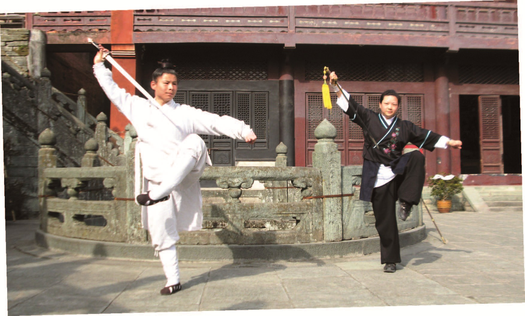 Left: Two Taoist priests practice Wudang kung fu in front of the Purple Heaven Palace on Wudang Mountains in Hubei Province. — Wang Yong