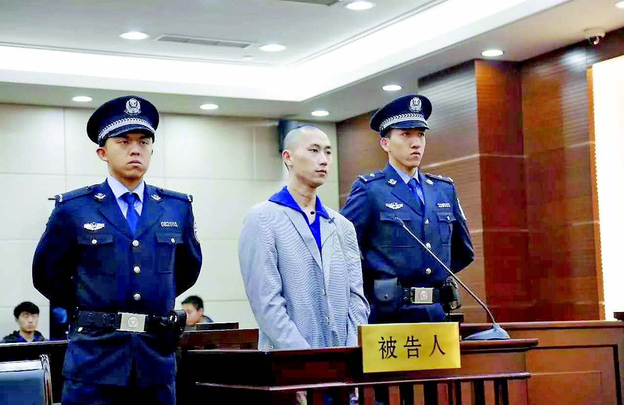 Zhou Xingbai in court yesterday as he is sentenced to eight years in jail for bombing the Pudong International Airport and injuring three people. — Ti Gong