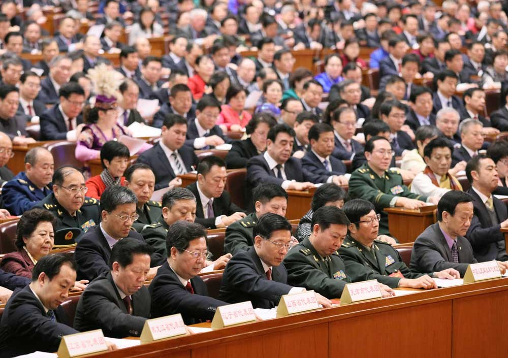 Deputies cast their votes during yesterday's session of the national legislature in Beijing. — Xinhua