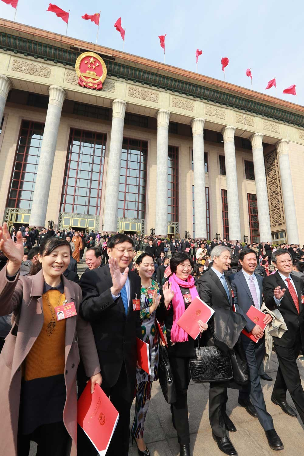 Deputies to the National People's Congress walk out of the Great Hall of the People in Beijing after China's top legislature concluded its annual session. — Xinhua