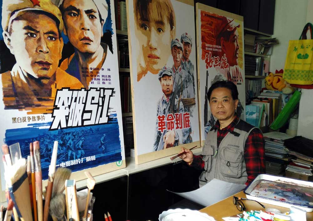 Li Shude paints the poster for a Chinese war movie at his studio in Shanghai.