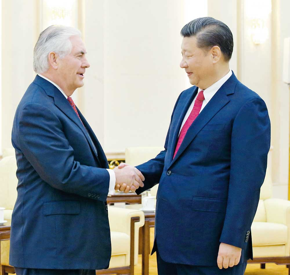 President Xi Jinping shakes hands with Rex Tillerson at the Great Hall of the People in Beijing yesterday on the final day of the US secretary of state's swing through Asia. — Xinhua